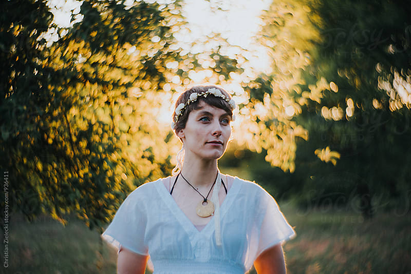 a bohemian bride in sunset light by Chris Zielecki for Stocksy United