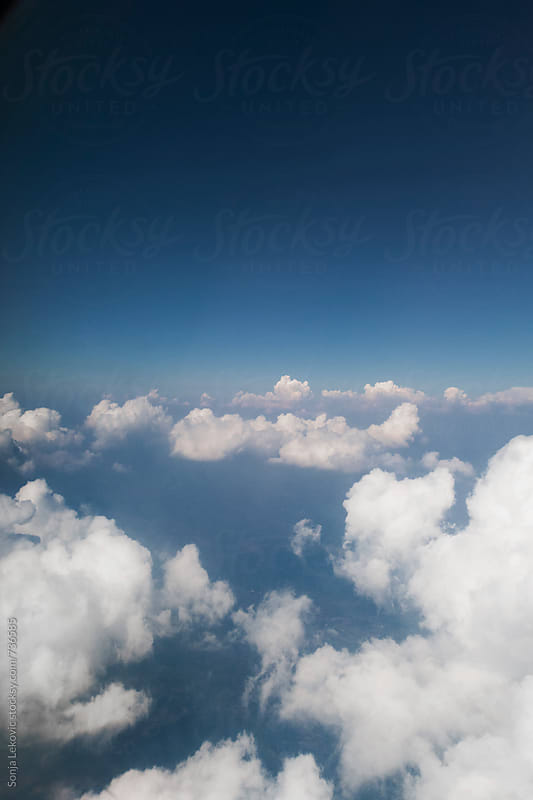 clouds and blue sky background by Sonja Lekovic for Stocksy United