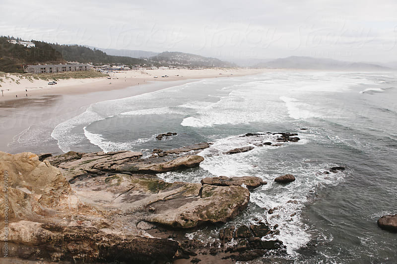 view of ocean from a rocky cliff by Nicole Mason for Stocksy United