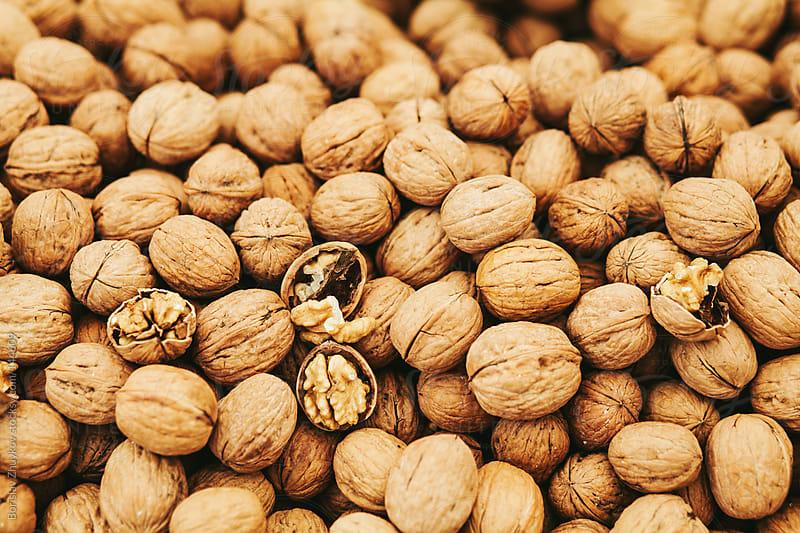 Walnuts in shell on the market by Borislav Zhuykov for Stocksy United