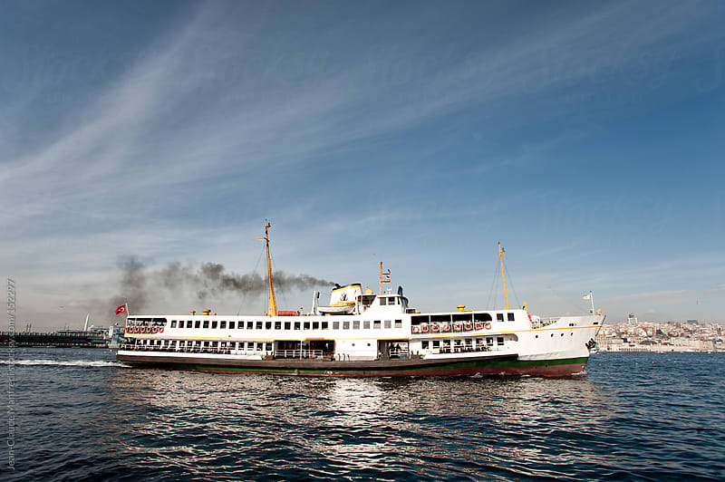 Tourist ferry sails the waters of the Bosphorus Istanbul by Jean-Claude Manfredi for Stocksy United
