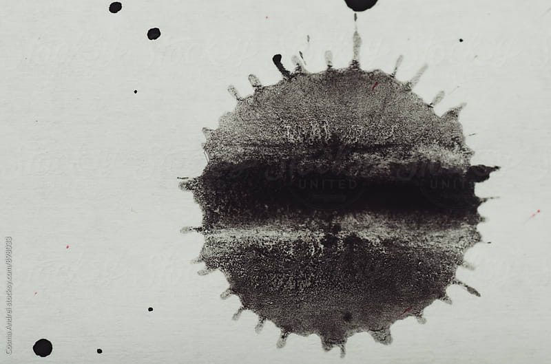 Black abstract ink painting on white paper by Cosma Andrei for Stocksy United