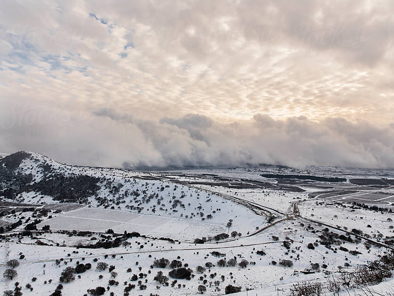 Storm clouds and snow on the Golan heights in Israel by Lior + Lone for Stocksy United