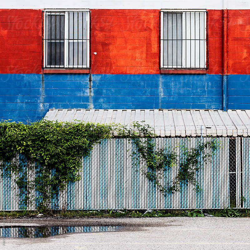Colorful striped and worn building by Kerry Murphy for Stocksy United