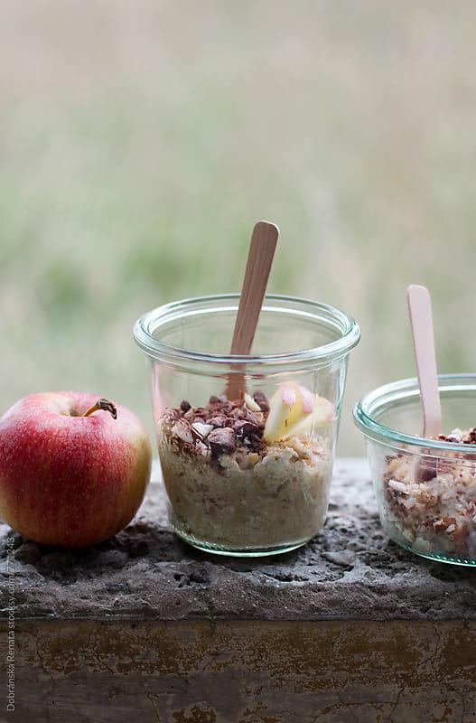 Porridge with apple,chocolate and almonds by Dobránska Renáta for Stocksy United