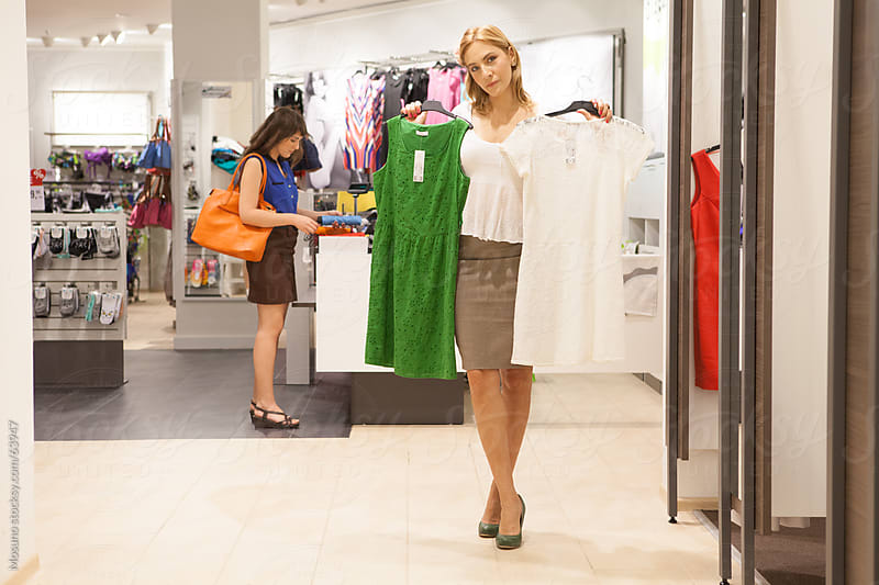 People shopping in a retail store. by Mosuno for Stocksy United
