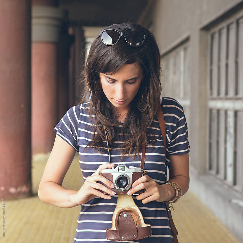 Woman Photographing Outdoors With an Old Camera by Lumina for Stocksy United