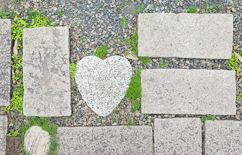 Heart shape bricks on garden sidewalk by Lawren Lu for Stocksy United