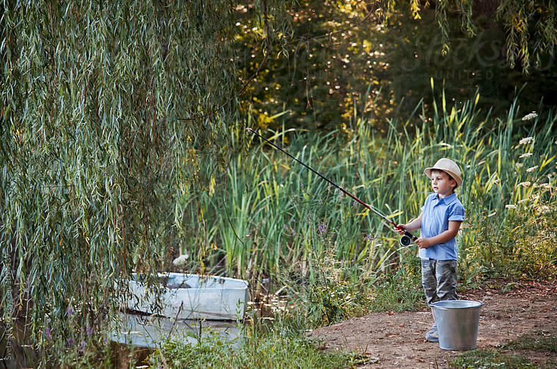 Little boy fishing. by Sveta SH for Stocksy United