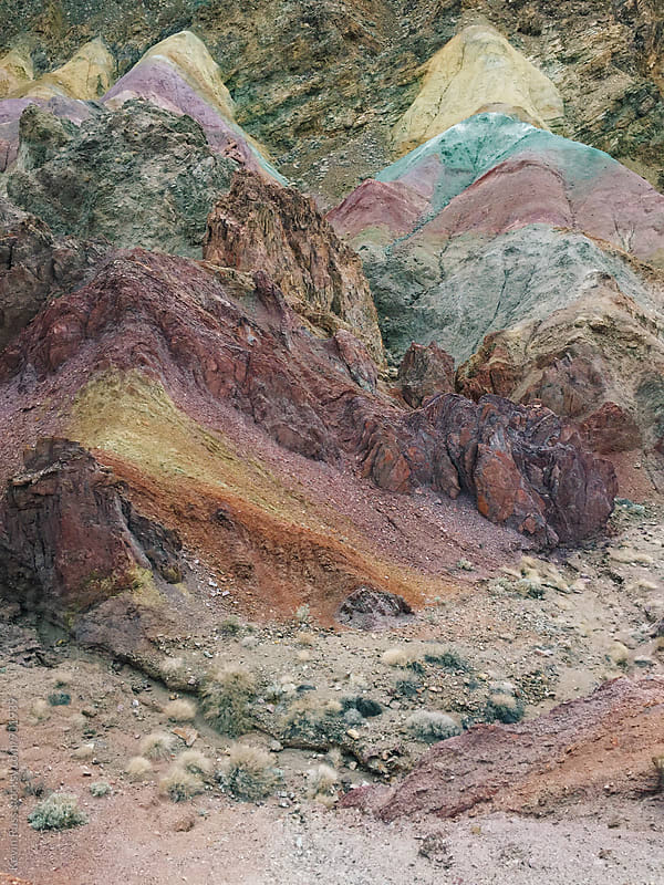 Rainbow Mineral Rocks in Desert by Kevin Russ for Stocksy United