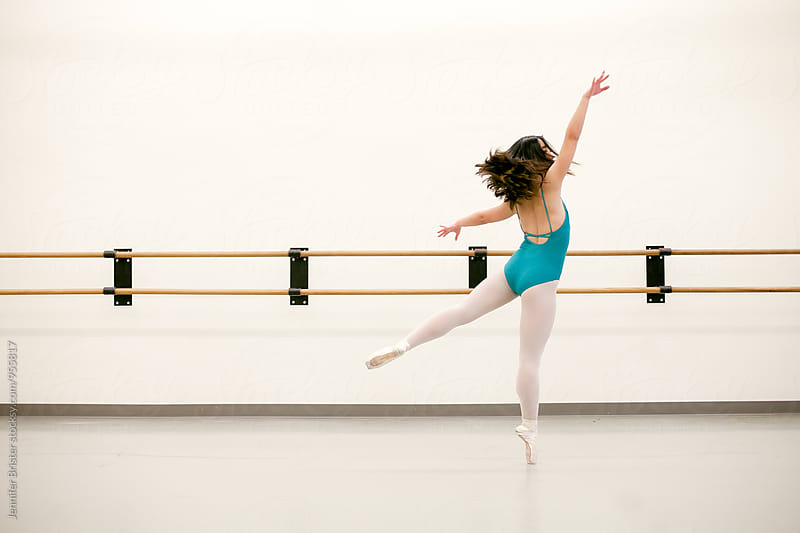 Woman dancing ballet in studio by Jennifer Brister for Stocksy United
