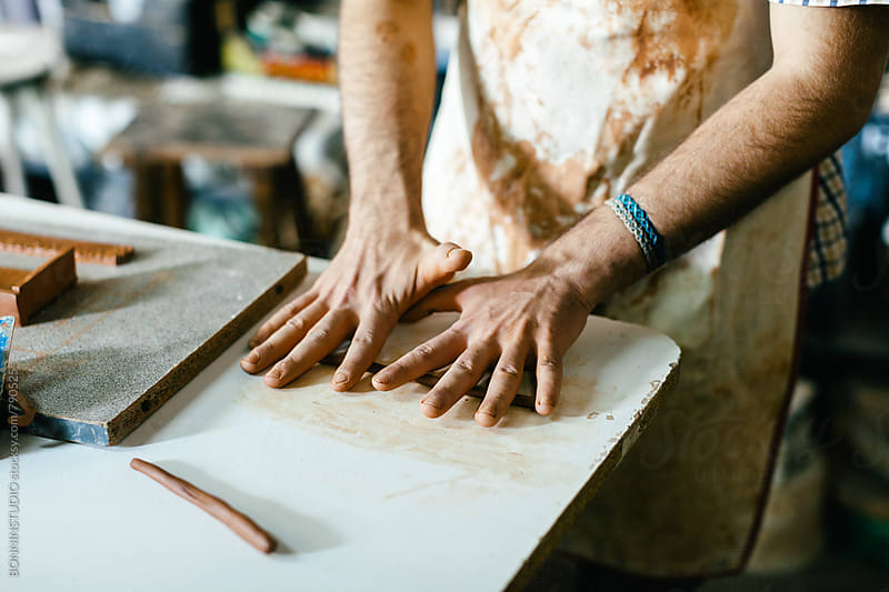 Hands of a ceramist working with clay. by BONNINSTUDIO for Stocksy United