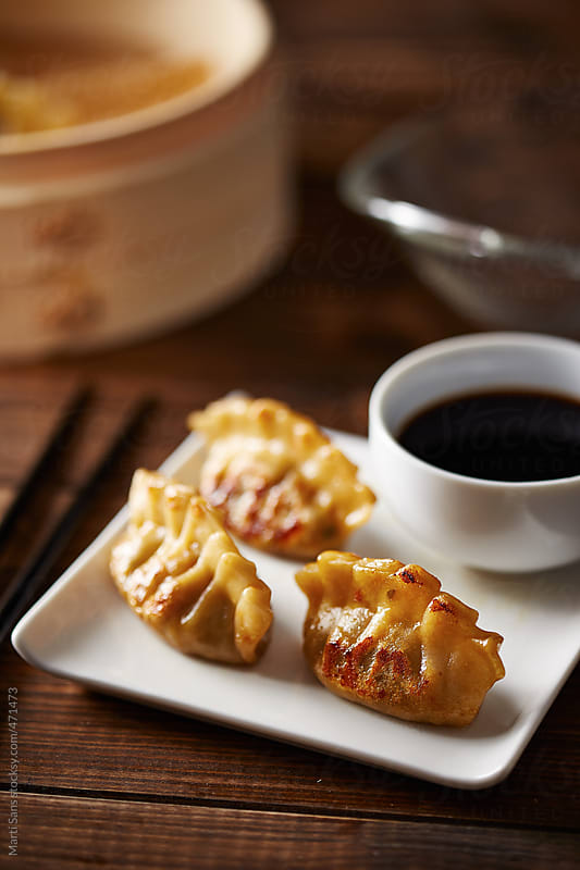 Chinese dim sum dumplings  by Martí Sans for Stocksy United