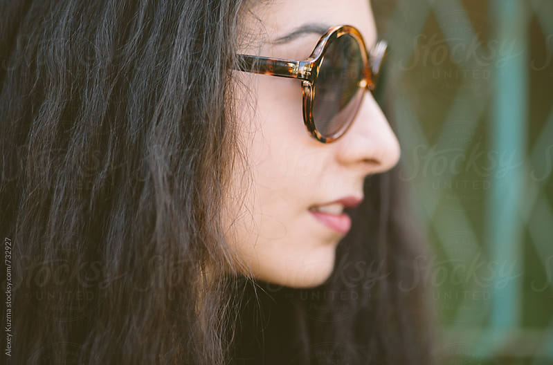 portrait of  young woman with retro sunglasses  by Vesna for Stocksy United