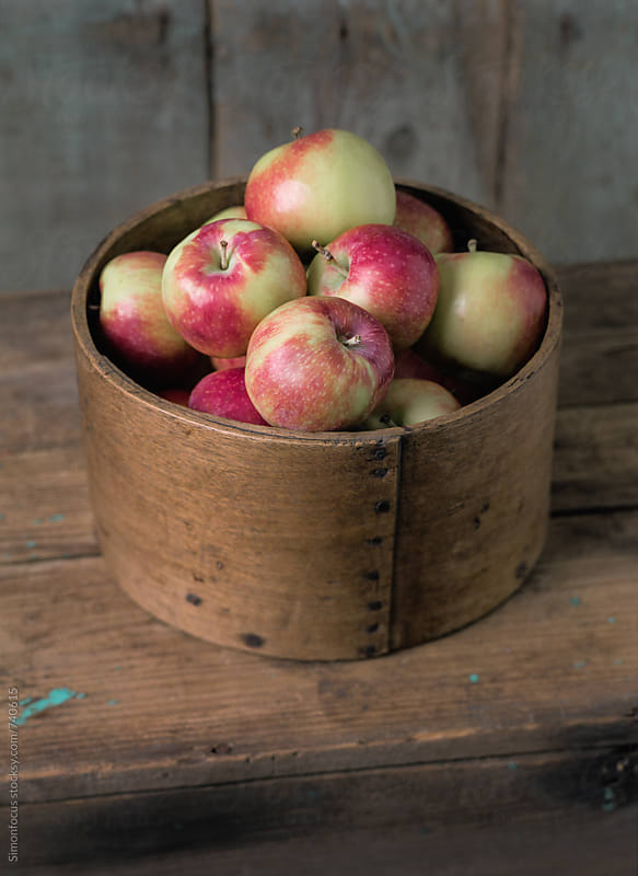 A generous half a peck of organic apples by Simonfocus for Stocksy United