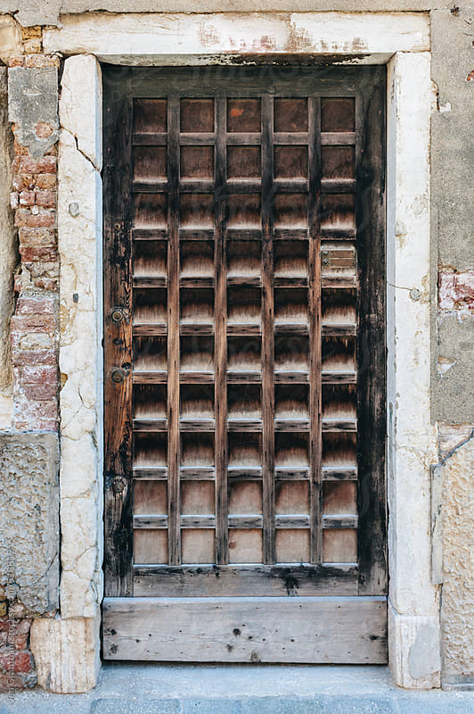 Wooden door in Venice, Italy by Jen Grantham for Stocksy United