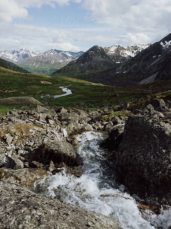 Stream Flowing Out Toward Mountains by Kevin Russ for Stocksy United