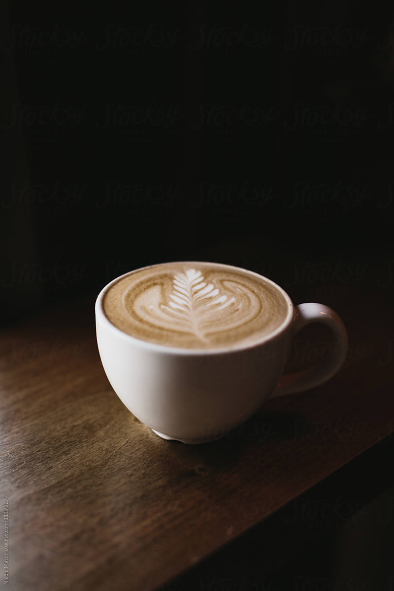Latte Art Coffee In White Mug On Dark Wood Table By Nicole Mason Coffee Aesthetic Stocksy United