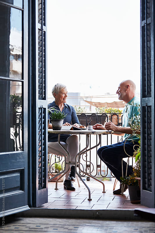 Senior Couple Having Breakfast On Balcony by ALTO IMAGES for Stocksy United