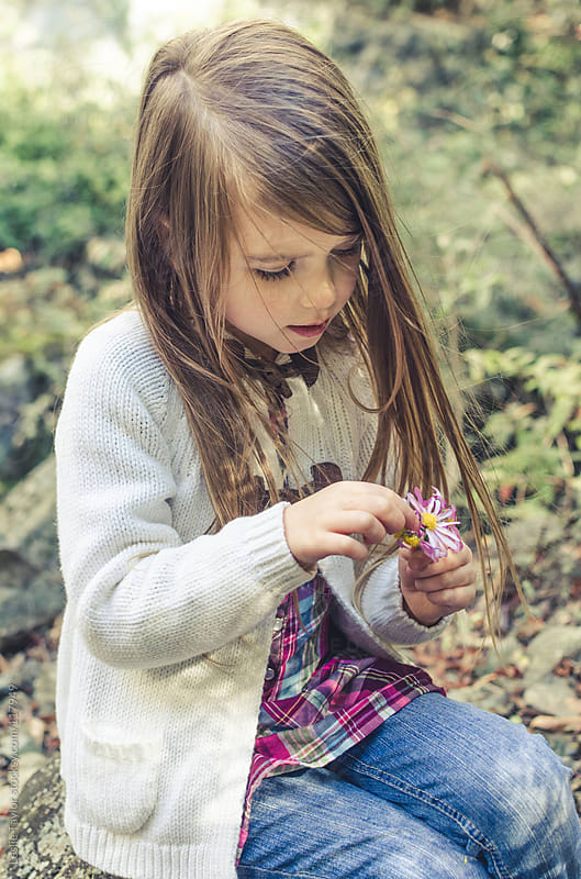Girl Playing With A Flower by Leslie Taylor for Stocksy United