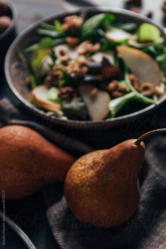 Delicious salad with pear, walnuts and hazelnuts by Nataša Mandić for Stocksy United
