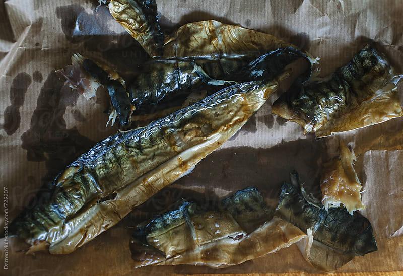 Skinned smoke mackerel fillets on brown paper. by Darren Muir for Stocksy United