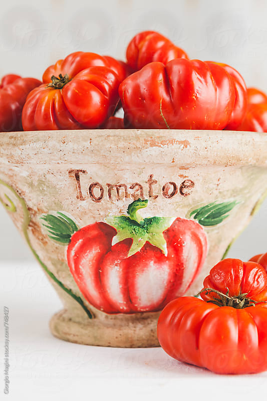 Fresh Florentine Ribbed Tomatoes on a Vase, Costoluto Fiorentino by Giorgio Magini for Stocksy United