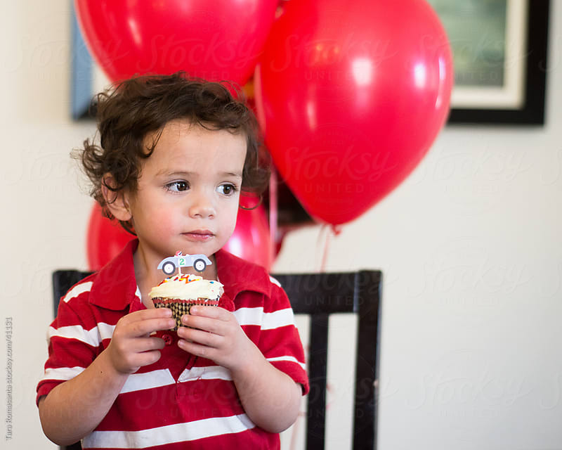 a little boy and his cupcake before it gets messy by Tara Romasanta for Stocksy United