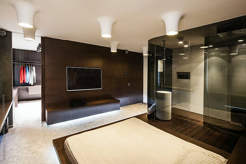 Modern bedroom in contemporary interior by Aleksandar Novoselski for Stocksy United