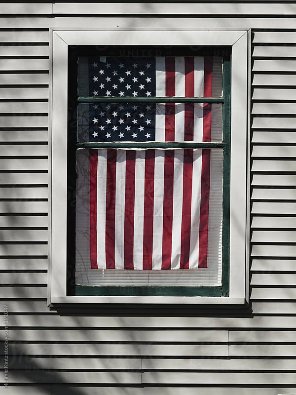 Window with American Flag by Melanie Kintz for Stocksy United