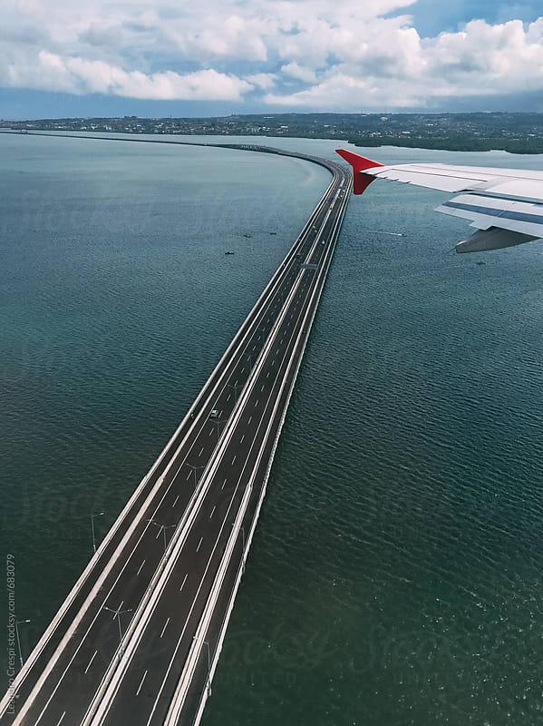 Long cross-sea bridge by Leandro Crespi for Stocksy United