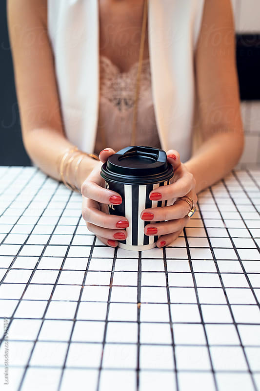 Hands of a Woman Holding a Coffee Mug by Lumina for Stocksy United