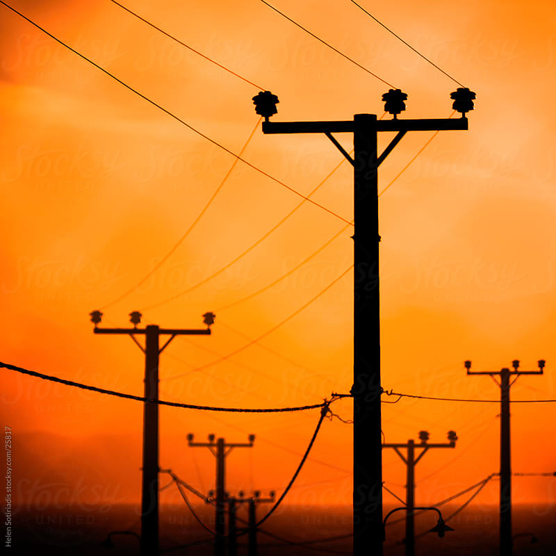power lines and cables at sunrise by Helen Sotiriadis for Stocksy United