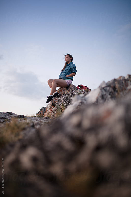 Fit active hiker resting on top of a mountain by Ani Dimi for Stocksy United