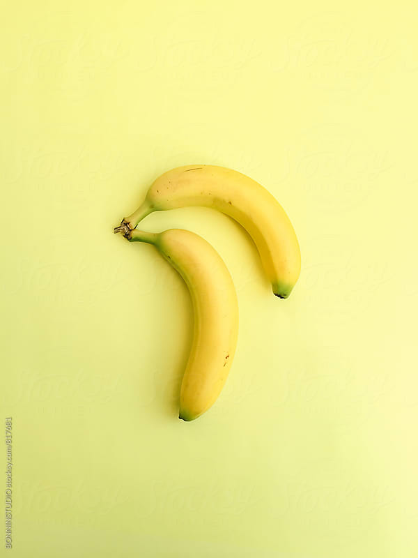 Overhead of bananas on yellow background. by BONNINSTUDIO for Stocksy United