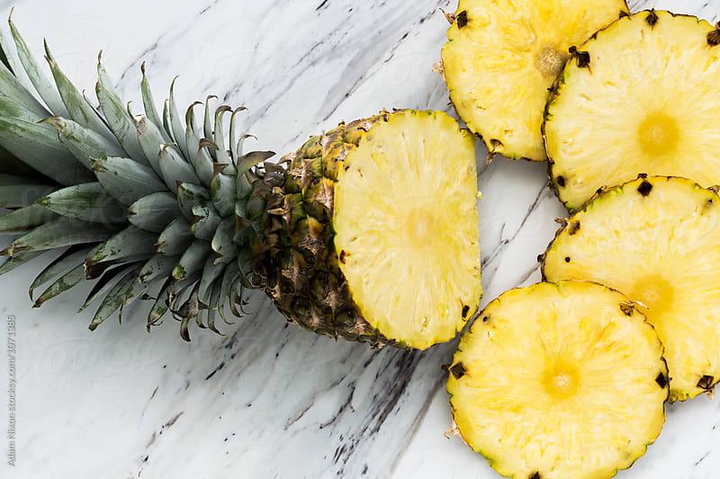 Fresh sliced pineapple by Adam Nixon for Stocksy United