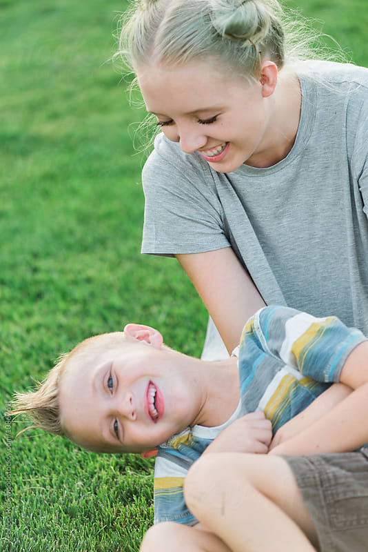 happy brother and sister by Rebecca Rockwood for Stocksy United