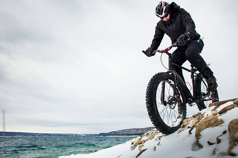 Extreme Sport Winter Mountain Bike Rider on Fat Bike In Snow by JP Danko for Stocksy United
