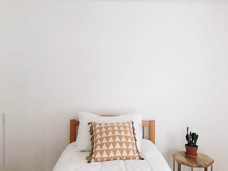 Minimalist bohemian guest bedroom by Daring Wanderer for Stocksy United