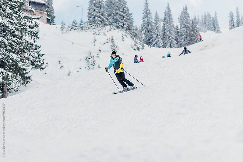 Woman skiing down the slope by Boris Jovanovic for Stocksy United