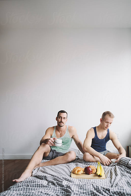Gay Jock Lovers Having Breakfast in Bed by Joselito Briones for Stocksy United
