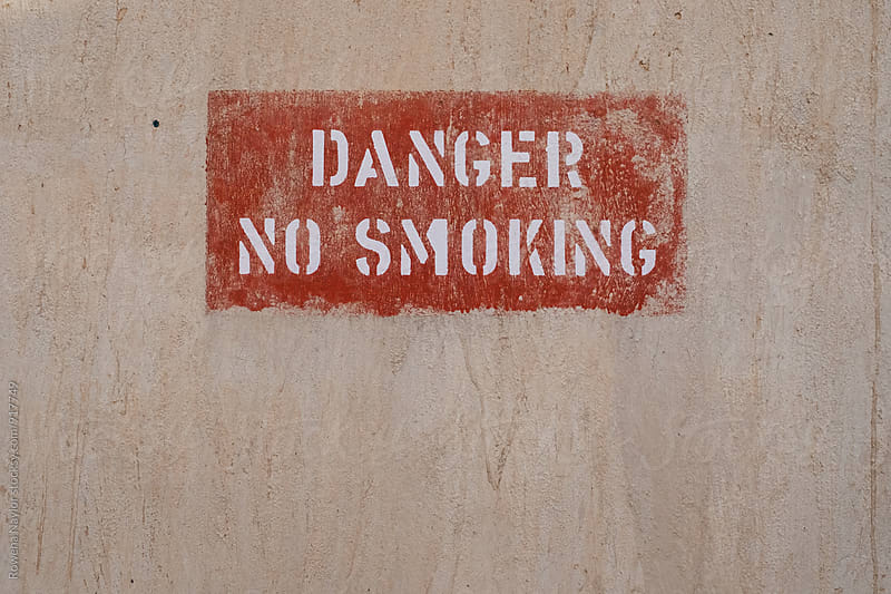 Danger No Smoking sign by Rowena Naylor for Stocksy United