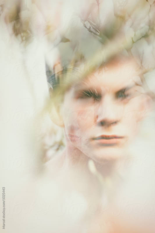 Boy and magnolia double exposure by Marcel for Stocksy United