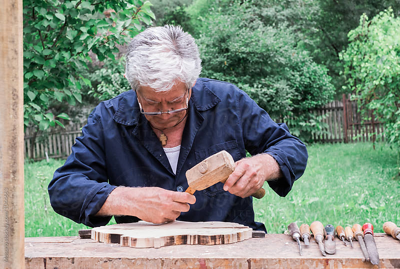 Craftsman Working Outdoors by Mosuno for Stocksy United