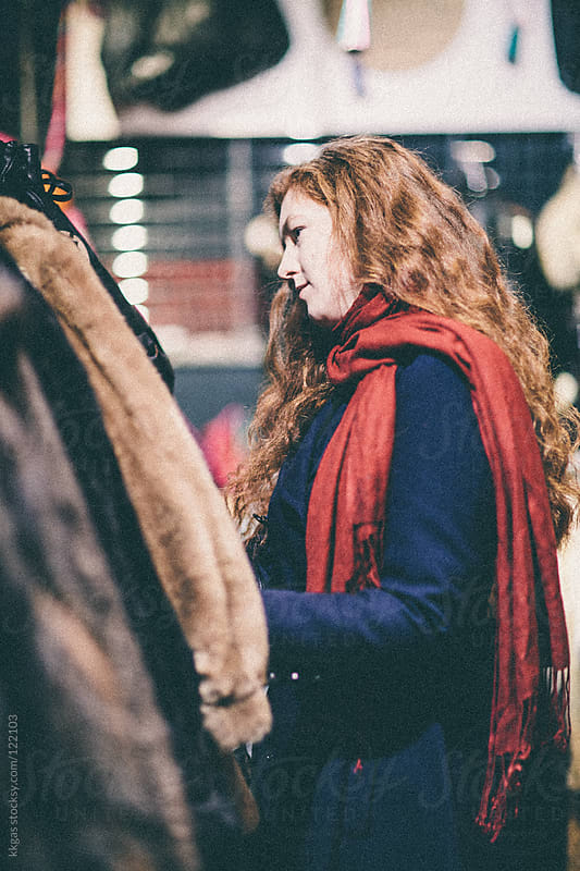Red headed woman shopping for clothes  by kkgas for Stocksy United