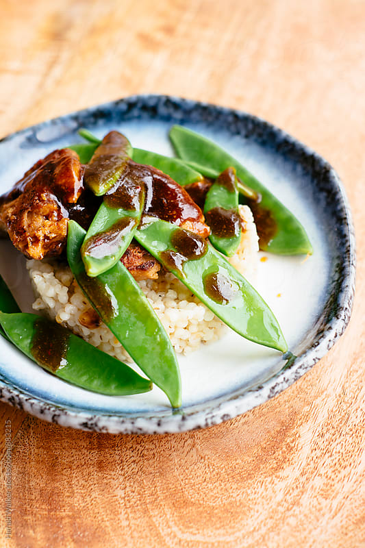 Textured Vegetable Protein on Barley with Snow Pea Pods by Harald Walker for Stocksy United