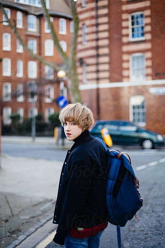 Young Woman With a Backpack in the City of London by HEX. for Stocksy United