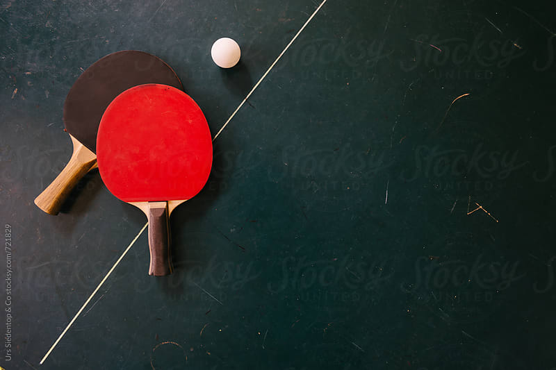 Ping pong rackets and table tennis ball by Urs Siedentop & Co for Stocksy United