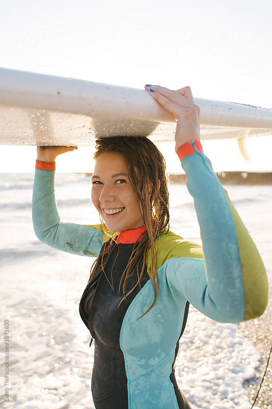 Pretty Girl Smiling with Surfboard in Summer by Caleb Thal for Stocksy United