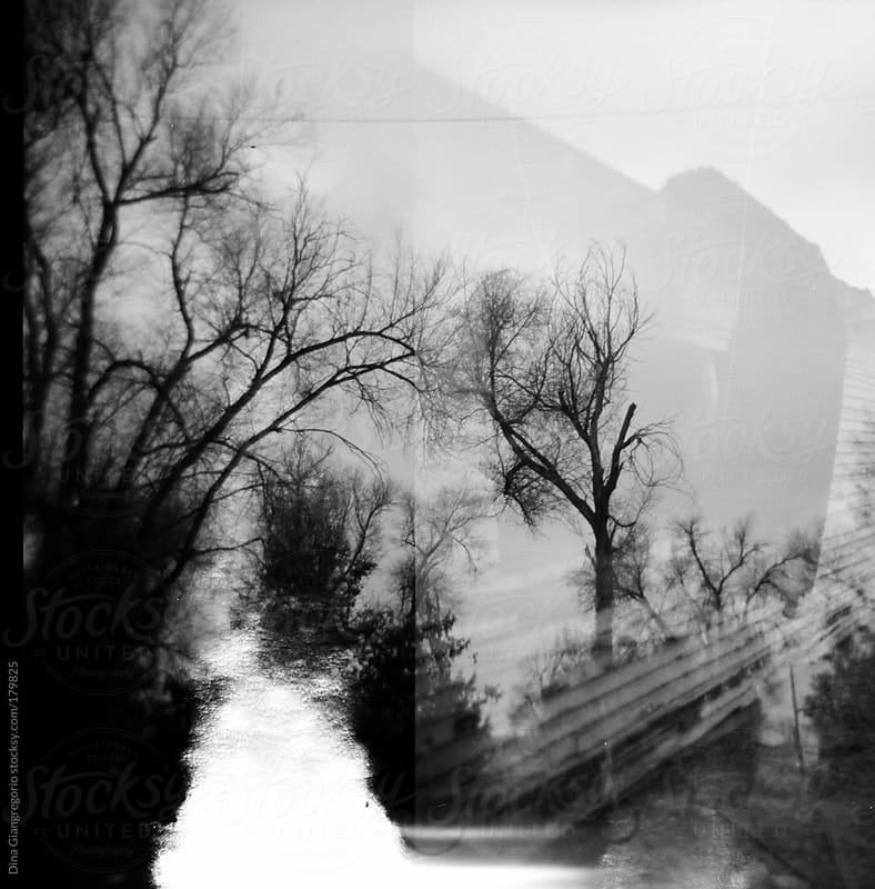 Multiple film exposures showing trailer, creek and trees by Dina Giangregorio for Stocksy United